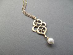 Gold Art Nouveau Pendant with Lustrous Pearl. 21.00 dollars, via Etsy.