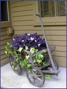 wagon planter..... I have always wanted a goat cart.... still looking for one!