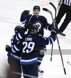 Patrik Laine #29, playing his first NHL game, of the Winnipeg Jets celebrates scoring his first NHL goal against the Carolina Hurricanes during NHL action on October 22, 2016 at the MTS Centre in Winnipeg, Manitoba.
