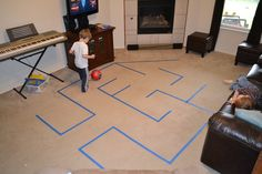 Teach ball control with a painters-tape maze (can also be done outside). It turns learning to dribble into a game. This could work with teaching little kids to play!