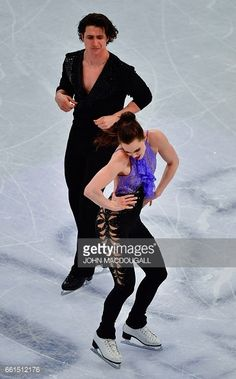 Canada's Tessa Virtue and Scott Moir compete in the ice dance/short dance event at the ISU World Figure Skating Championships in Helsinki, Finland on March 31, 2017. / AFP PHOTO / John MACDOUGALL (Photo credit should read JOHN MACDOUGALL/AFP/Getty Images)