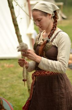 Spinning wool the ancient way.