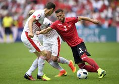 Albania's midfielder Ermir Lenjani (R) vies for the ball during the Euro 2016 group A football match between Albania and Switzerland at the Bollaert-Delelis Stadium in Lens on June 11, 2016. / AFP / MARTIN BUREAU