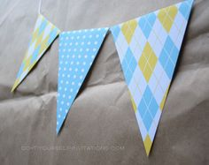 Printable bunting flags, part of our Birdie Mobile baby shower kit: available in pink or blue.