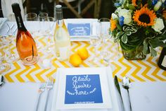 Glad you're here signs always bring a smile to your guests faces! (Event Production by Hand Made Events Table Design by PopUp Weddings Photography by Sorella Muse Photography Florals by Farmgirl Flowers) #ledinersf2014 #popupweddingsbyhme #tablesetting #gladyourehere #blueandyellow