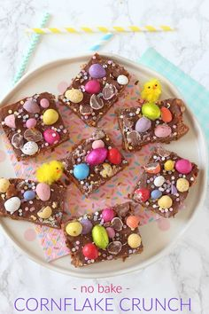 A delicious no-bake Easter delicious made with cornflakes, chocolate and peanut butter and topped with Mini Eggs and Smartie Eggs!