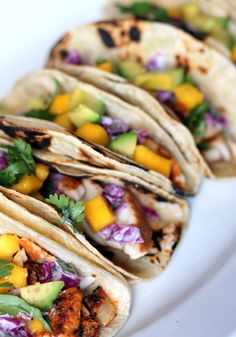 Grilled Chili Lime Fish Tacos with Sour Cream Cabbage Slaw, Mango, and Avocado