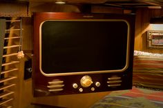 Amazing transformation of a modern flatscreen TV into a vintage-looking result done by vintage-vactions