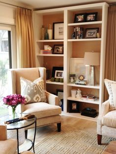 Living room shelving. Buy shelves and knock the back out. A great way to decorate without Putting holes in the wall.