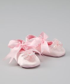 Sweeten up tiny toes with these shimmery satin shoes. Pearl-centered pink flowers and pretty ribbon ties make the perfect accompaniment to a new party dress. 100% polyesterMachine wash; tumble dryImported | Assembled in the USA