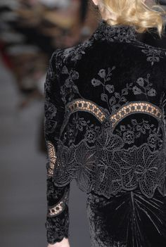 This black velvet evening gown by Elie Saab is adorned with black lace and applique. (Hope it's lined.)