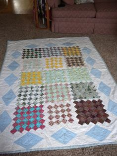 I love the colors in this vintage quilt. The center part has color coordinated 2 squares set on point in blocks of 49 squares. The border has