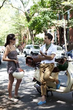 LOVE this whole composition.  The man's turquoise Tom's, the leather bag on the vespa, the vespa, the dress & shoes on the girl.  ME!  On the Street….The Summer of The Blue Shoe, New York « The Sartorialist