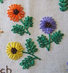 Embroidered flowers worked in detached chain stitch, stem stitch and french knots