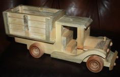 This is a very large truck it is 15 inches long and over 7 inches high.  It is made of pine.  It is not from a kit.