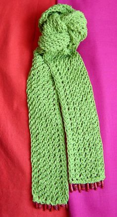 """Green lace scarf knit pattern      Worsted Weight/20 sts x 26 rows = 4""""/10cm    Yarn (as shown in photo)    Needle Size - 6mm (US10/CAN4)    Bead Trim (optional)      Finished Size: (as shown in photo)  Width x Length  3"""" x 66""""/8cm x 165cm"""