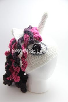Homemade by Giggles: Unicorn Hat - FREE Crochet Pattern!  Make this adorable unicorn hat yourself for free.  Pink and purple unicorn hat for child or toddler.