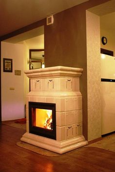 Kominek kaflowy z manufaktury Riwal. Piec kaflowy. Tiled fireplaces. http://www.ceramikaiszklo.riwal.pl