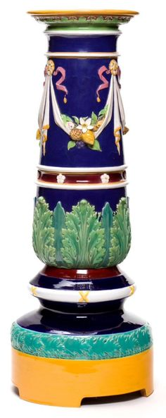 Minton Majolica Pedestal. The yellow and gray green foot seems to be a replacement. The original pedestal has a foot of the same shape but the green band at the top is suspicious and the foot is almost always cobalt blue. This was probably not intended to deceive.