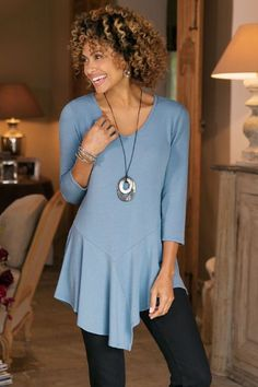 """Add a little swing to your saunter. Asymmetrical panels form a flutter peplum hem on this casual chic tunic, softly draping in textured jersey with V-neck and 3/4 sleeves. Poly/rayon/spandex. Misses 22-1/2""""/34"""" long. Modernista Tunic #2AM06"""
