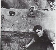The original photo shows Gefreiter Walter Junge showing off battle damage on his tank which occurred at Sailley on August 26th 1944. The Tiger was numbered 301. Unit was 3./schwere Panzer-Abteilung 503. There was NO damage done to the 150mm front plate.