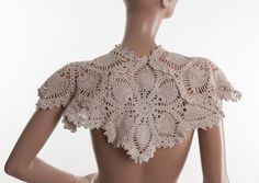 Upcycled vintage doilies shrug capelet off white. $55.00, via Etsy.