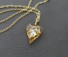 Shining Heart necklace: sparkly, Swarovski crystal heart pendant in light gold on gold-filled chain by SilverlightJewellery for $65.00