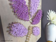 Create with texture, color, and dimension :: DIY: Wall Art From Yarn + Nails, via Lion Brand Notebook.