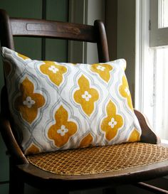 hand printed gray and yellow ochre ogee on white linen lumbar pillow. $52.00, via Etsy.