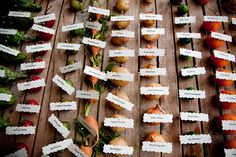Vegetable place cards match the vegetable centerpieces on the tables - darling for a farm wedding!