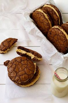 Brownie Cookie Sandwiches with Peanut butter Frosting, with milk bottle