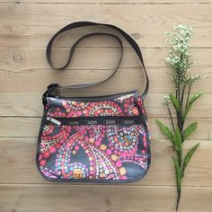 *SOLD* NWOT LeSportsac Crossbody Bag Brand new without tags super cute flower print bag with three zipper compartments.  Adjustable strap.  In new condition. LeSportsac Bags Crossbody Bags