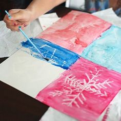 Draw with white crayon and them let the kids paint to reveal the drawings