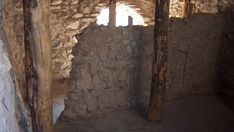 *ARIZONA~Inside Tuzigoot Pueblo What is Tuzigoot? Take our loop walk to find out about this pueblo, and the people who lived here. A masonry room with exposed wooden support poles.
