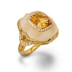 De Boulle Collection Citrine Cocktail Ring A golden Citrine surrounded by Diamonds is set in frosted Quartz. Yellow Sapphires and Diamond adorn the mounting and the shank.