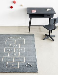 Hopscotch Rug.  Perfect for children's bedrooms, playrooms, and schools.  Woven from a synthetic wool for a strong and robust finish, so even with intensive use the rug surface will maintain its design and colours. Easy to clean, water resistant, anti-static, anti-bacterial, anti-dust mite and helpful for noise reduction.