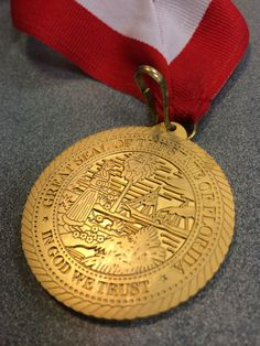 This side of the medal shows the Great Seal of the State of Florida: In God We Trust
