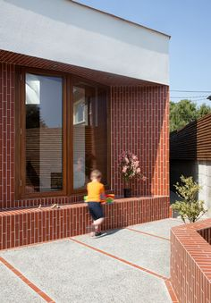 The full potential of terracotta tiles seen on this house in Dublin. Use our Rosso Brick tile with a white grout to recreate this look! http://www.skheme.com/Code.aspx?ID=ROSSO%20BRICK