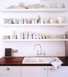 Open shelving above sink