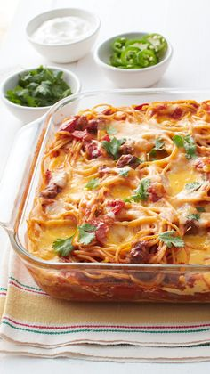 This easy, family friendly casserole, dotted with melty pockets of cheese, proves that tacos and spaghetti are a match made in heaven. Garnish with sour cream, sliced jalapeño chiles and chopped fresh cilantro for extra freshness.