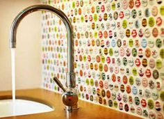 This is a surprisingly cool repurposing project. A bottle cap backsplash that very colorful.