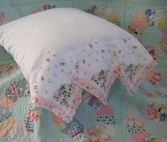 Hanky edge pillow case and old quilt via Susan Branch by mae