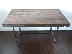 reclaimed wood desk or table with industrial black pipe base from RECLAIMBK (Brooklyn based)