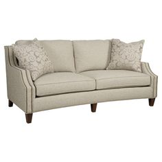 Sofa with nailhead trim and 2 throw pillows. Made in the USA. Product: Sofa Construction Material: Wood and fabr...