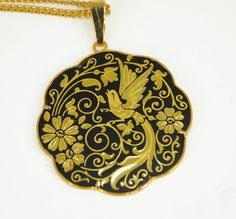 An example of hand made Vintage Damascene Necklace Gold Toledo Spain. I watched artisans make this type of jewelry and purchased a cross necklace.