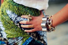 Gilded nails, sparkle baby ring finger, bee, chunky bracelets. Perfection.