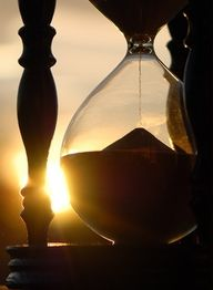 hourglass with sunset behind it. TATTOO SLEEVE!