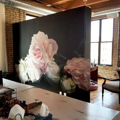 Create a separation in open spaces, like this kitchen and living room, with large artwork or by using a wallpaper wall mural on a large piece of suspended wood - Unique Living Room Ideas & Decor - Install of Thomas Darnell's piece Peonies Pink