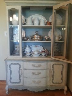 Here is a beautiful one-of-a-kind French Provincial China Hutch featuring custom painted details using Annie Sloan Chalk Paint in two-tone