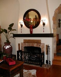 The Arts and Crafts Fireplace that I redesigned to be Spanish Colonial to fit the style of the rest of the house.